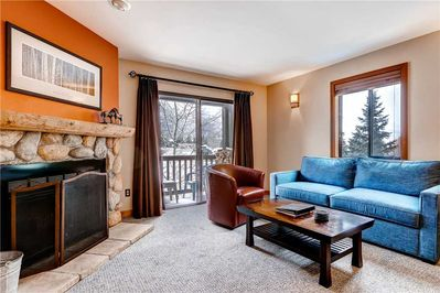 Relaxing living room warm wood burning fireplace - Park City Lodging-Powder Pointe 201B