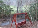 Creekside swing allows you to relax and unwind. Listen to the babbling creek.