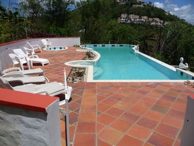 Relax by the 50' Pool, Overlooking the Ocean and Windjammer Resort