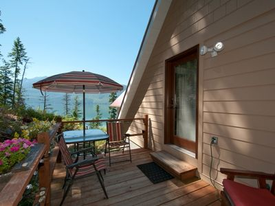 Relax on the private deck of the Studio Suite and enjoy the lake view.