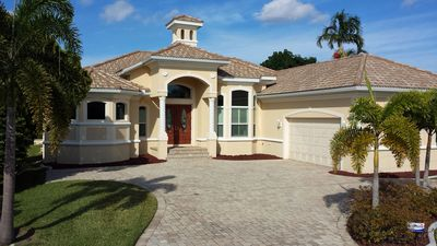 Photo for New 4 BR/ 4 BA pool home.  Best location In Cape Coral on canal, walk to beach