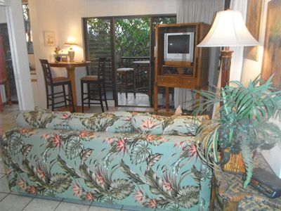 View of the lanai and TV and dvd from the queen bed. Lots of light and privacy.