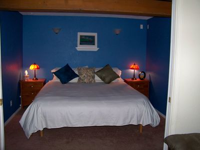 comfy king sized bed in room that can be completely darkened