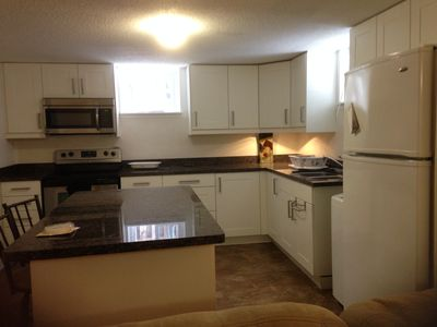 Newly renovated kitchen with granite counter tops and granite dinning table