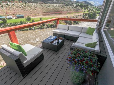 Photo for Two minutes from Yellowstone Park with private river access, 30ft. Deck & BBQ.
