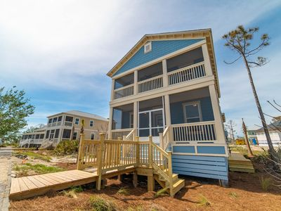 Photo for Brand new home with Gulf views from all floors and very easy beach access! Gorgeous interior, community pool, 3.5 miles of bike path along the water, and more!  Sleeps 9. Free $200 beach gear credit for 2019 Summer bookings!