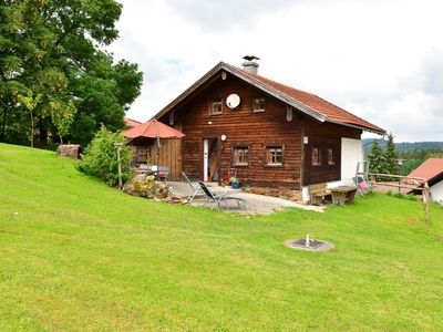 Photo for Detached wooden holiday house in the Bavarian Forest with sun terrace and garden