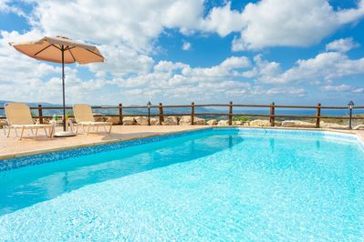 Private pool and terrace with panoramic views of the sea and countryside