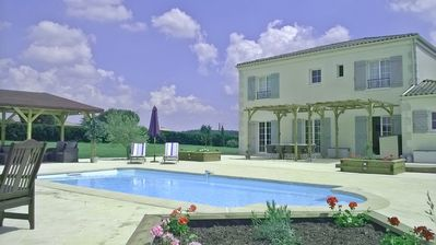 Photo for Surrounded by the Bordeaux Vignobles, Bonté is a beautiful home with a lush pool