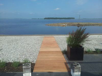 Photo for Comfortable holiday home directly on the Veluwemeer with beautiful lake view