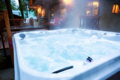Soak in this 7 person spa under the pines and stars.