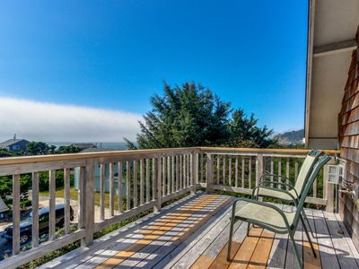 Photo for Dog-friendly home w/ocean views, private hot tub & entertainment - walk to beach