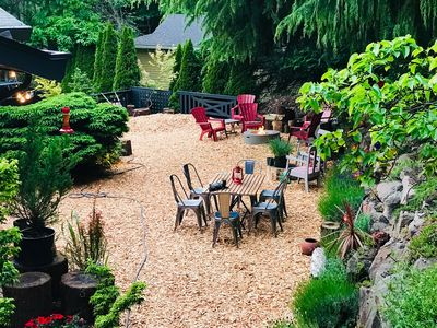Expansive yard space with fire pit for dining, relaxing