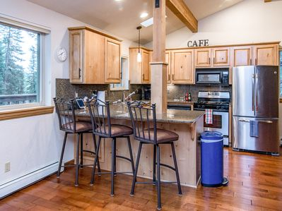 Kitchen - The breakfast bar offers seating for 3.