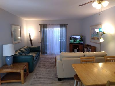 Living room and dining room. Cable TV and high speed wireless internet provided.