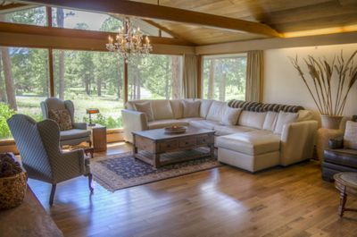 The living room offers stunning views of Longs Peak, nestled in  quiet serenity.