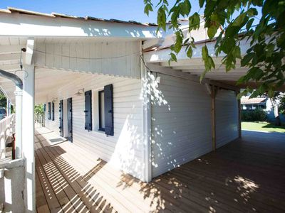 Photo for Family atmosphere for this villa all in wood and its large terrace.