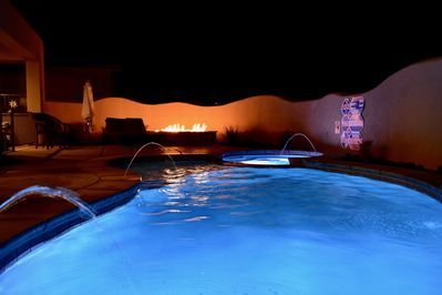 Enjoy your own private pool with custom lighting and water fount