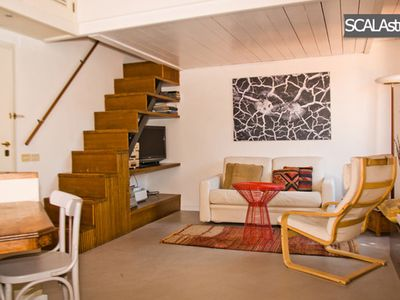 Photo for Beautiful penthouse with panoramic terrace in Trastevere