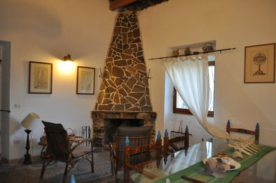 """""""Asfodelo"""" Dining room with fireplace"""