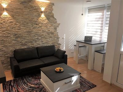 Photo for Modern bright 2-room apartment in a central but quiet top location with balcony