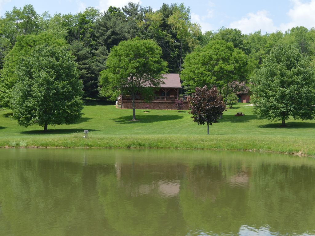The lodge at babble brook large log cabin on 12 private for Private fishing ponds near me