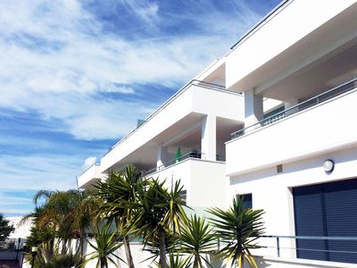 Photo for Penthouse with sun terrace, pool, wifi, garage,1800 m from beach