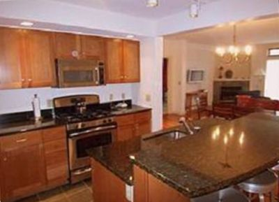 Kitchen with stainless steel appliances, granite counter tops, and tile floors.