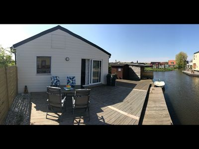 Photo for Modern, bright holiday home with lots of sun and private jetty