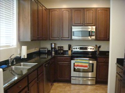 Large open kitchen with stainlees steel appliances