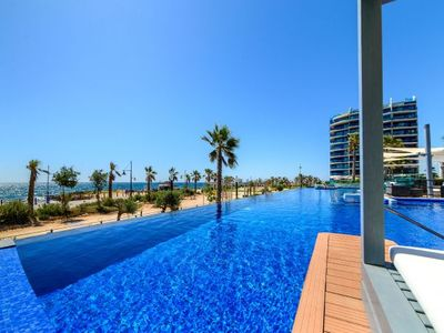 Photo for Punta Prima Apartment, Sleeps 4 with Pool, Air Con and WiFi
