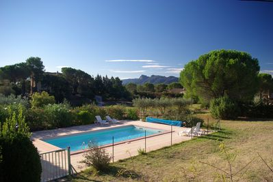 View of the swimming pool and the Roquebrune rock in Argens