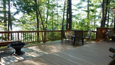 Photo for Lakeside Cottage in the Pine Woods with Huge Deck and Sunset Views