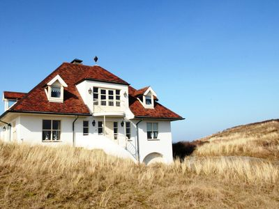 Photo for Luxurious holiday home with billiards table and sauna, atop the dunes in De Koog