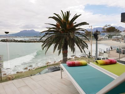 Enjoy the waves crashing from your private balcony with BBQ facilities