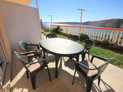 Photo for Two bedroom apartment with terrace and sea view Vlašići (Pag)