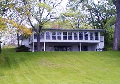 Clear View Lakefront Home with 17 window porch facing the lake.  Amazing Views!