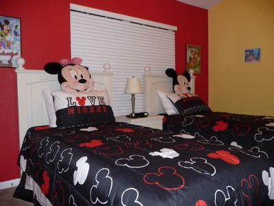 Disney Room features two twin beds, new flat screen TV, PS2, and new mattresses.