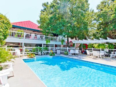 Photo for Cute Cottage Style Apartment with Shared Pool and only 1.5 Blocks to Beach