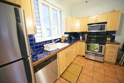 Full modern kitchen with all the amenities, and passthrough to the dining room