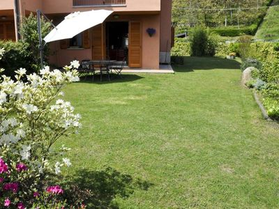 Photo for Apartment with swimming pool and private garden on Lake Maggiore