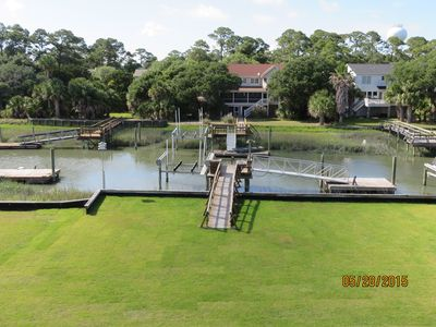 Backyard canal dock and floating platform for boating/kayaking/fishing and peace