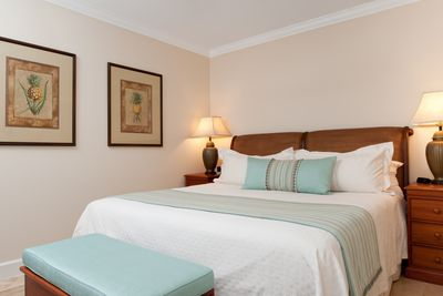 The bedroom of unit 501 includes a king size bed
