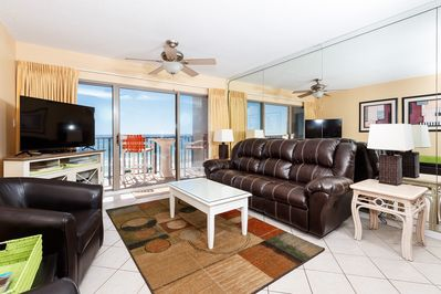 Living Room - Snuggle up for a movie or watch the majestic waves crash on the beach