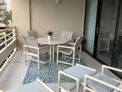 Oceanfront Balcony with New Table & 4 Chairs + Two additional Seats w/Ottomans