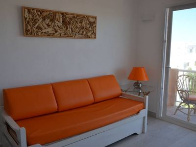 Photo for Es Pujols: Bright apartment just steps from the beach, Free WiFi.
