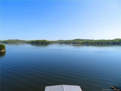 Photo for Perfect lakefront home for family reunions! Private pool, hot tub, dock