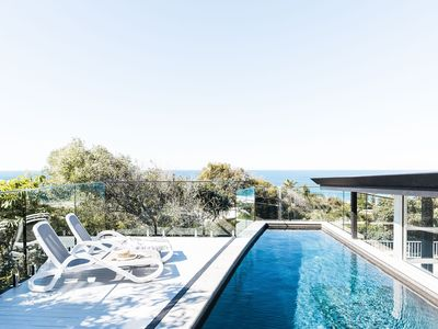 Photo for Designer beach house - 4 bedrooms, pool, decks and stunning ocean views!