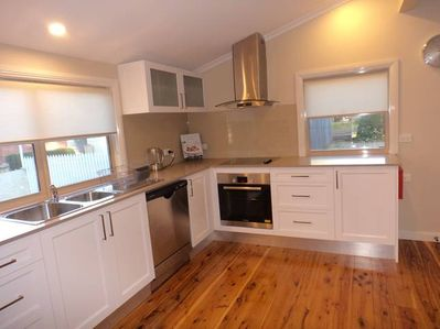 Well appointed kitchen with stone tops/glass splashbacks and S/S appliances