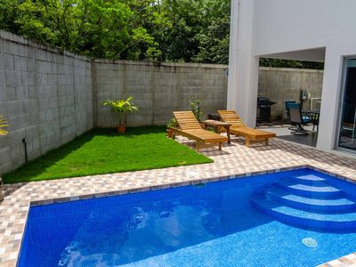 Photo for Modern Townhome with Pool - Secure, Walk to Town and Beach
